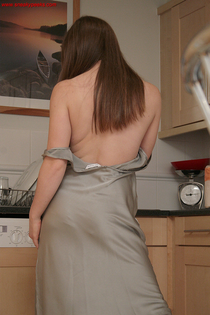 A sneak peek at a hot UK brunette seen undressing in a room, exposing her sexy body in panties